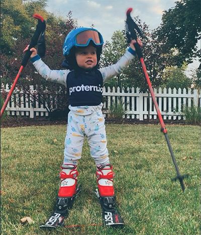 Protern toddler on skis